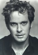 Tom Hollander as Adam Smallbone
