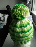 green bobble hat